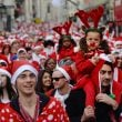Thousands celebrate christmas during santacon parade in London
